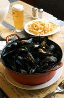 A dutch oven full of mussels