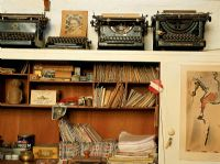 Writing desk with a collection of old typewriters