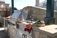 Outdoor grill and stone counter