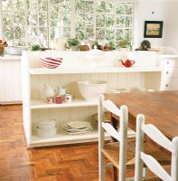 Crockery on shelf with dining table