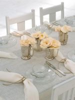 Dining table with flower vase and napkins