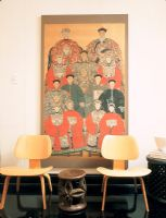 Two chairs with an Asian portrait painting