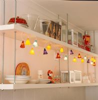 Crockery on shelf with electric lights