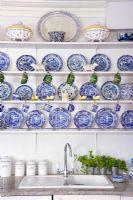 Crockery display above kitchen sink