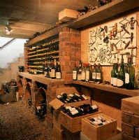 View of wine bottles and crates in wine cellar