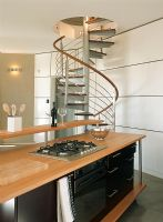 A contemporary wooden kitchen and spiral stairs