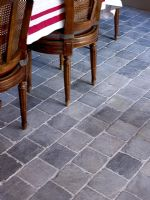 Stone floor tiles in dining room