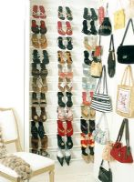 Shoes in rack and shopping bags hanging on wall
