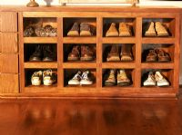Collection of shoes on shelf