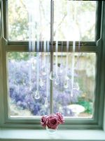 Roses in glass on window sill