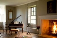 Music room with roaring fire