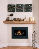 Fireplace with nautical accesories on shelf