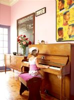 A little girl playing the piano