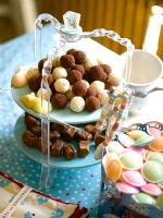 Cake stands full of chocolates and sweets