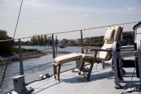 Sun lounger on deck of modern houseboat