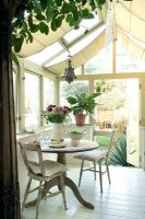 Table and chairs in modern conservatory