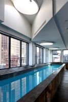 Indoor swimming pool with views of New York