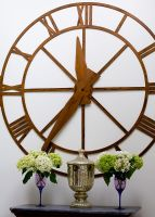 Large wooden wall clock detail