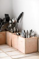 Cutlery and utensils in storage pots