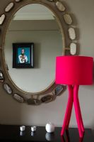 Sideboard mirror and red lamp