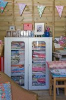 Floral fabrics in vintage display cabinet