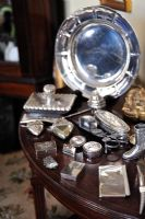 Silverware on side table, detail