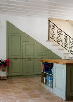 Kitchen with built in under-stair cupboards