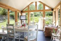 Wooden framed conservatory dining room