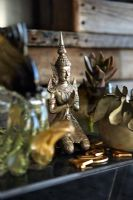 Brass statue on shelf, detail
