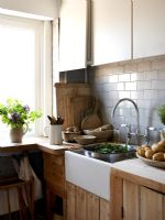 Butler sink in modern country style kitchen