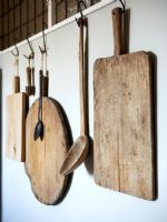 Wooden chopping boards and utensils, detail