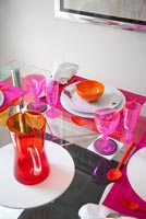 Elevated view of colourful glassware on dining table