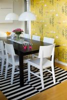Dining table on black and white rug