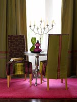 Furniture on bright pink rug