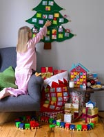 Girl opening Advent calendar at Christmas