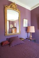 Classic bedroom with purple painted walls