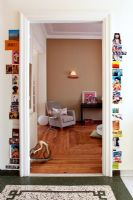 Door framed by display of photos and postcards