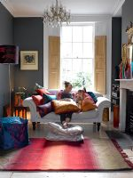 Woman and child in colourful living room