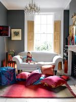 Child sitting on sofa in colourful living room