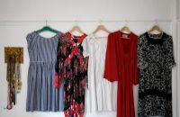 Collection of vintage dresses hanging up