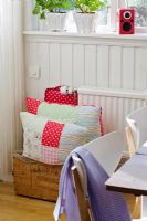 Patchwork cushions in country dining room