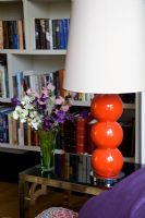Red lamp on side table