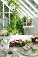 Conservatory with flower arrangements on table
