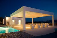 Contemporary villa with terrace and pool at night
