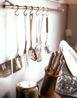 Kitchen utensils hanging from rack