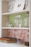 Detail of shelf unit with patterned wallpaper