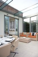 Dining room and seating area in conservatory