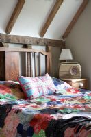 Country bedroom with patchwork quilt