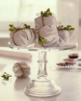 Decoratively wrapped cakes on cake stand