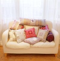 Sofa full of patterned cushions
